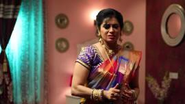 adithya reveals to purushothaman that mithra is nandini s sister sembaruthi